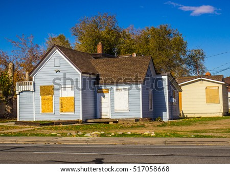 Abandoned Home With Boarded Up Doors & Windows