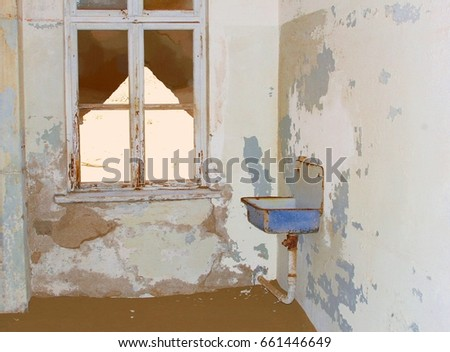 abandoned hospital room with...