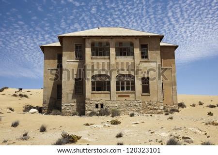 "Abandoned house of the colony ""Kolmanskop&qu ot; in Namibia - stock photo"