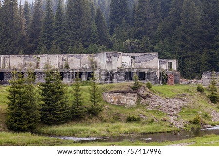 Abandoned house, old decayed building, in nowhere. Many broken windows. Smashed walls, urbex surrounded by meadow and forest. View without people. #757417996