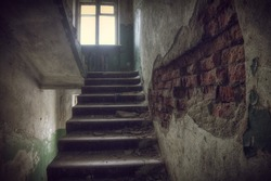 Abandoned house.Staircase in an abandoned house
