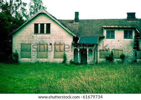 Abandoned house with asbestos cement sheeting. Creative coloring of image in green hue
