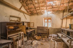 abandoned house with broken roof and trash laying on the floor at La Gomera, Canary islands, Spain. Decayed interior in an empty room at spooky and lonely place