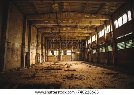 Abandoned industrial creepy warehouse inside old dark grunge factory building, toned