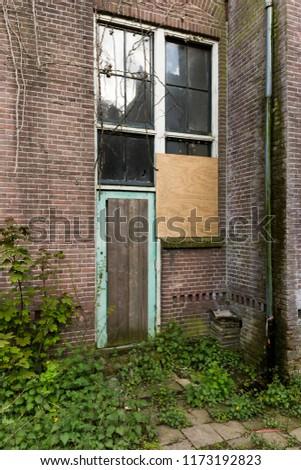 Abandoned Industrial Door #1173192823