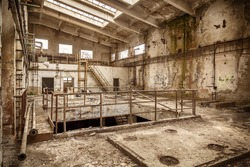 Abandoned industrial interior with stair