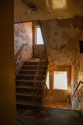 Abandoned industrial stairwell discovered in derelict urbex exploration