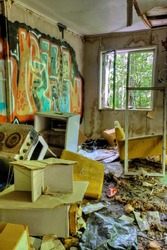 Abandoned, messy and trashed house interior with graffiti on walls