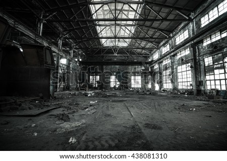 Abandoned metallurgical factory interior and building waiting for a demolition. stock photo