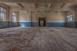 Abandoned military complex of the land forces - Peshtera, Bulgaria - gymnasium with rotten wooden floor - perespective