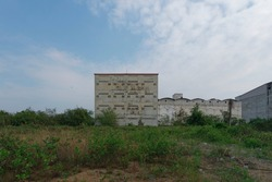 Abandoned Mysterious Building apart on sultry land in Phetchaburi, Thailand
