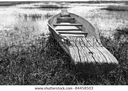 Abandoned native Thai style wood boat in black and white