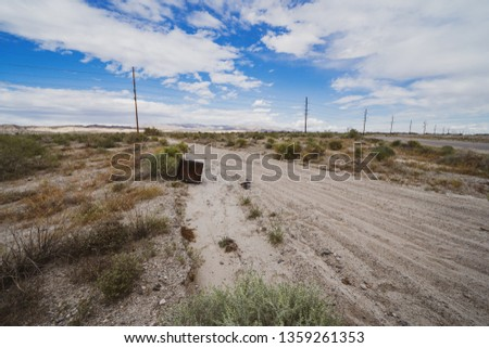 Abandoned obsolete CRT Television from the 1990s sits alongside a lonely dirt desert road in the Salton Sea area of California #1359261353