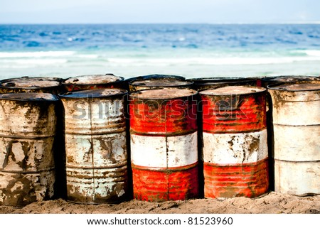 Abandoned oil barrels on the beachfront