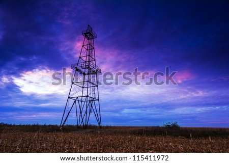 Abandoned oil rig, dramatic clouds and evening sky