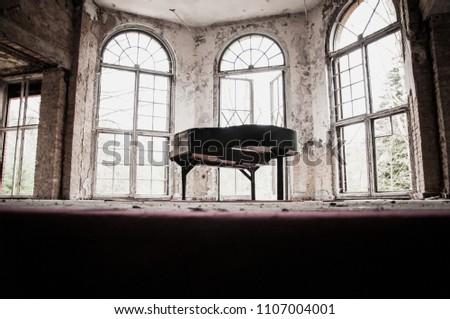 abandoned old german theater - destroyed piano on stage - scary haunted old house #1107004001