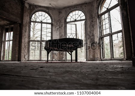 abandoned old german theater - destroyed piano on stage - scary haunted old house #1107004004