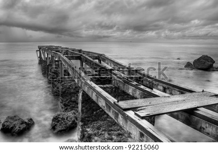Abandoned old pier shot in black and white