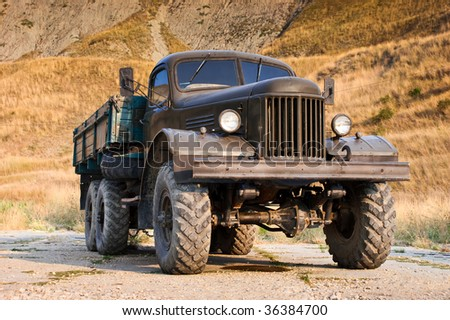 Abandoned old truck standing alone near the hill