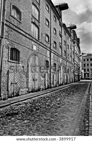 Abandoned old warehouse buildings. Black and white photo