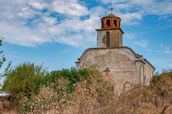 Abandoned Orthodox Church overgrown with trees, grasses and shrubs in the village of Matochina, Southeastern Bulgaria, Sakar Mountain