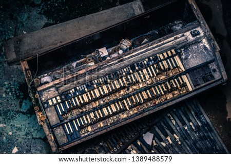 Abandoned piano in an abandoned building #1389488579