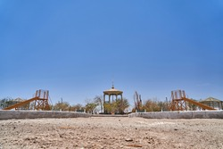 abandoned playground in a ghost town in the atacama desert of CHile, South America. Lonely and lost place