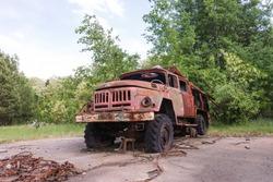 Abandoned radioactive vehicle, fire truck near Circle radar complex at Duga antenna, summer season in Chernobyl exclusion zone, Ukraine
