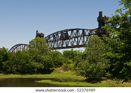 Abandoned railroad bridge over the Arkansas River, Little Rock, Arkansas - stock photo