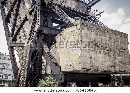 Abandoned railway raised bridge with concrete block #705416845