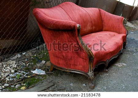 Abandoned Red Couch in an Alley