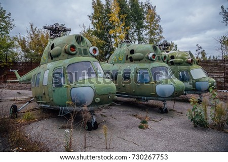Abandoned Russian military helicopters on derelict military airfield