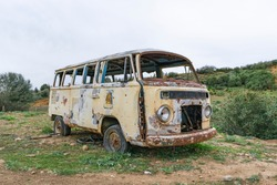 abandoned rusted car with wheels