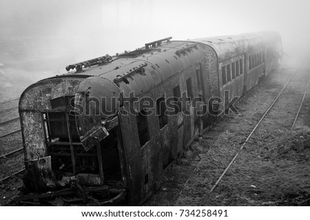 Abandoned rusting train photographed in a foggy day in the village of Paranapiacaba, Sao Paulo, Brazil. Photo in black and white.