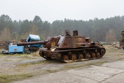abandoned self-propelled artillery unit ISU-152 on the territory of the former vehicle fleet of the abandoned city of pripyat