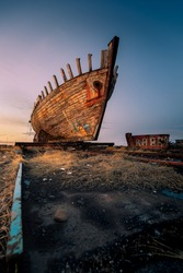 Abandoned shipwreck during sunset in Akranes - Iceland
