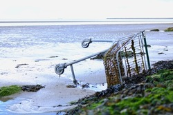 Abandoned Shopping Cart on Beach
