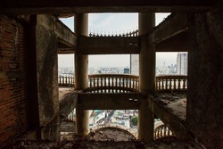 Abandoned skyscraper view, architecture skyline through abandoned balcony