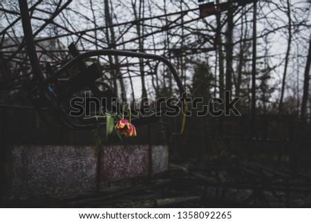 Abandoned swing in amusement park in pripyat, chernobyl area #1358092265