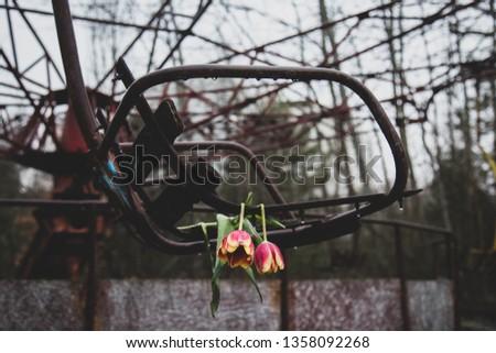Abandoned swing in amusement park in pripyat, chernobyl area #1358092268