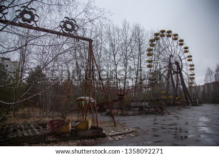 Abandoned swing in amusement park in pripyat, chernobyl area #1358092271