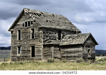 Abandoned 19th century house in a rural field in western America
