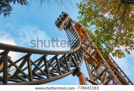 Abandoned theme park roller coaster ride in autumn in europe #778045183