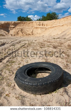 abandoned tire on sandy career