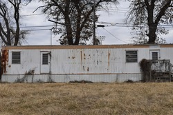 Abandoned trailer house with a yard