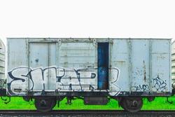abandoned train painted by graffiti.