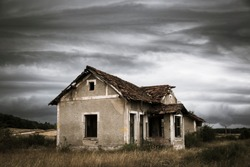 abandoned train station in Cabrejas del Pinar on a stormy day, province of Soria, Spain