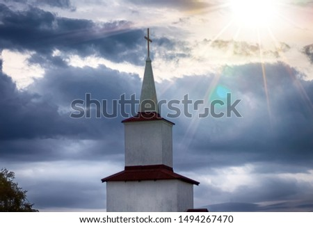 Abandoned village church on twilight sky background
