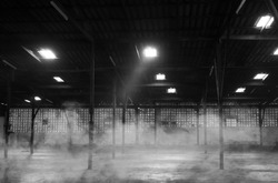 Abandoned warehouse. Black and white image. noise scene.