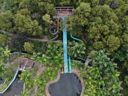 abandoned waterpark with wild growing trees in Vietnam